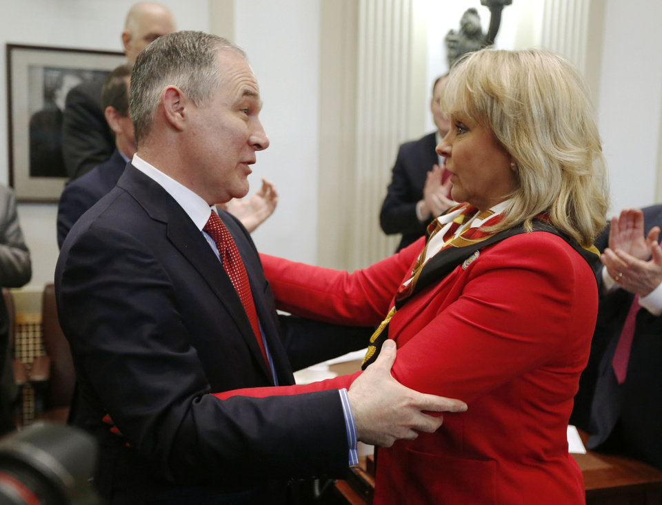 Photo - Oklahoma Attorney General and EPA Administrator appointee Scott Pruitt greets Governor Mary Fallin on the floor of the House of Representatives before her State of the State address at the State Capitol in Oklahoma City, Okla. Monday, Feb. 6, 2017.  Photo by Paul Hellstern, The Oklahoman