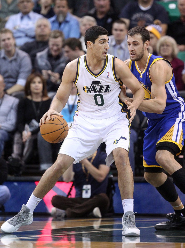 Photo - Golden State Warriors' Andrew Bogut, right, of Australia, guards Utah Jazz's Enes Kanter (0), of Turkey, in the first half during an NBA basketball game Monday, Nov. 18, 2013, in Salt Lake City. (AP Photo/Rick Bowmer)