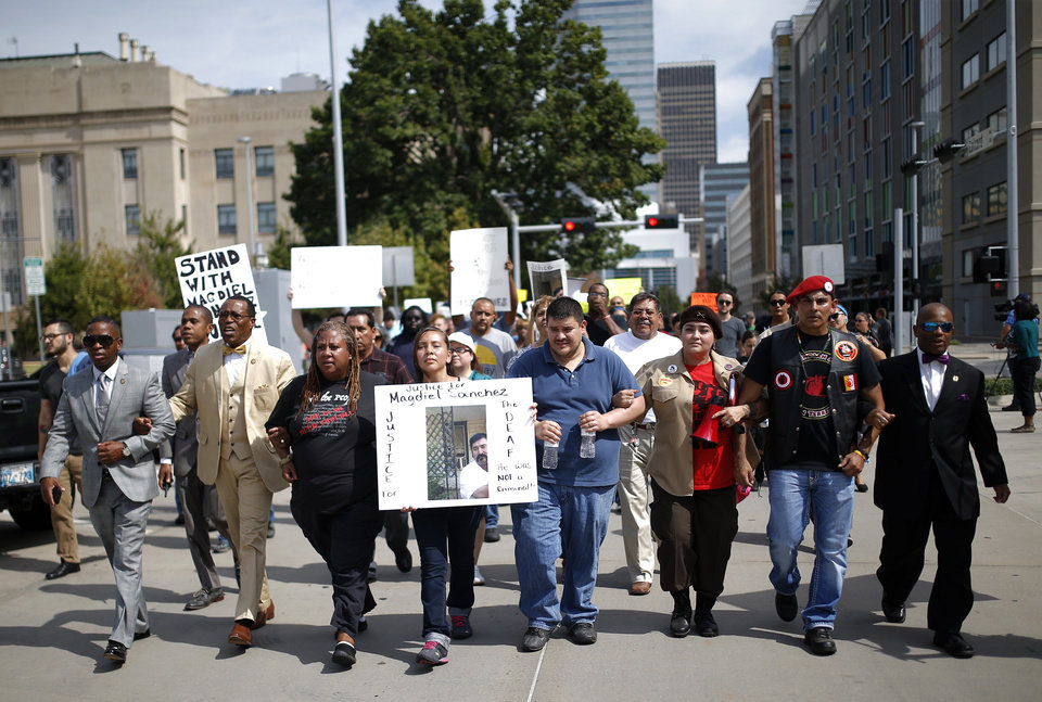 Photo - People march during the Justice for Magdiel Sanchez rally in Oklahoma City, Sunday, Sept. 24, 2017. Photo by Sarah Phipps, The Oklahoman