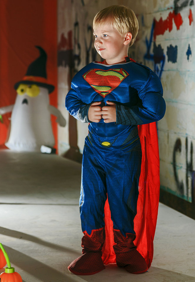 Photo - The Man of Steel will be flying to a home near you for trick or treat. Nolan is sporting a muscle jumpsuit, which has all the features seen in the latest Superman movie. Costume sold at Party Galaxy. Photo by Chris Landsberger, The Oklahoman  CHRIS LANDSBERGER
