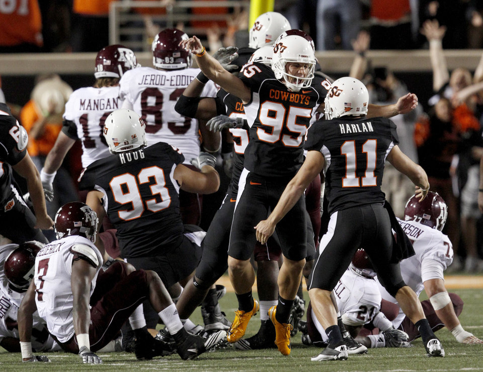 Photo - OSU's Dan Bailey celebrates after making the game-winning field goal during the college football game between Texas A&M University and Oklahoma State University (OSU) at Boone Pickens Stadium in Stillwater, Okla., Thursday, Sept. 30, 2010. Photo by Bryan Terry, The Oklahoman