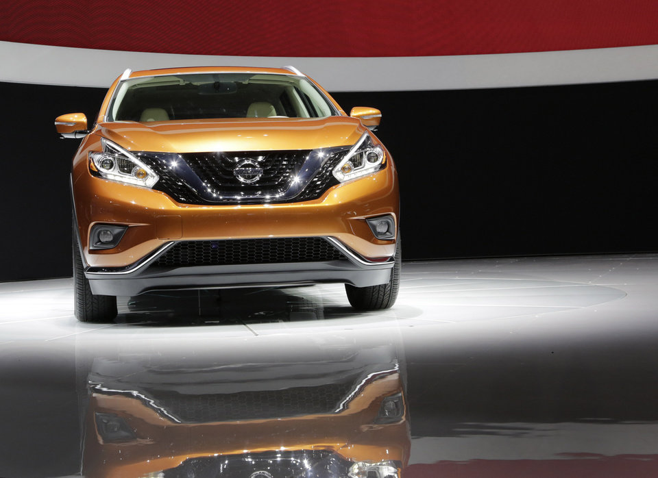 Photo - The 2015 Nissan Murano SUV is introduced at the New York International Auto Show, Wednesday, April 16, 2014, in New York. (AP Photo/Mark Lennihan)