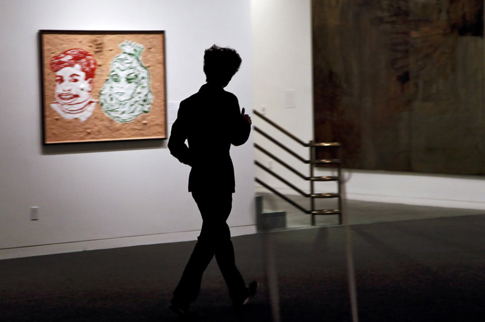 A visitor walks through the gallery at the Fred Jones Jr. Museum of Art on the University of Oklahoma campus on Tuesday , Dec. 4, 2012, in Norman, Okla.   Photo by Chris Landsberger, The Oklahoman