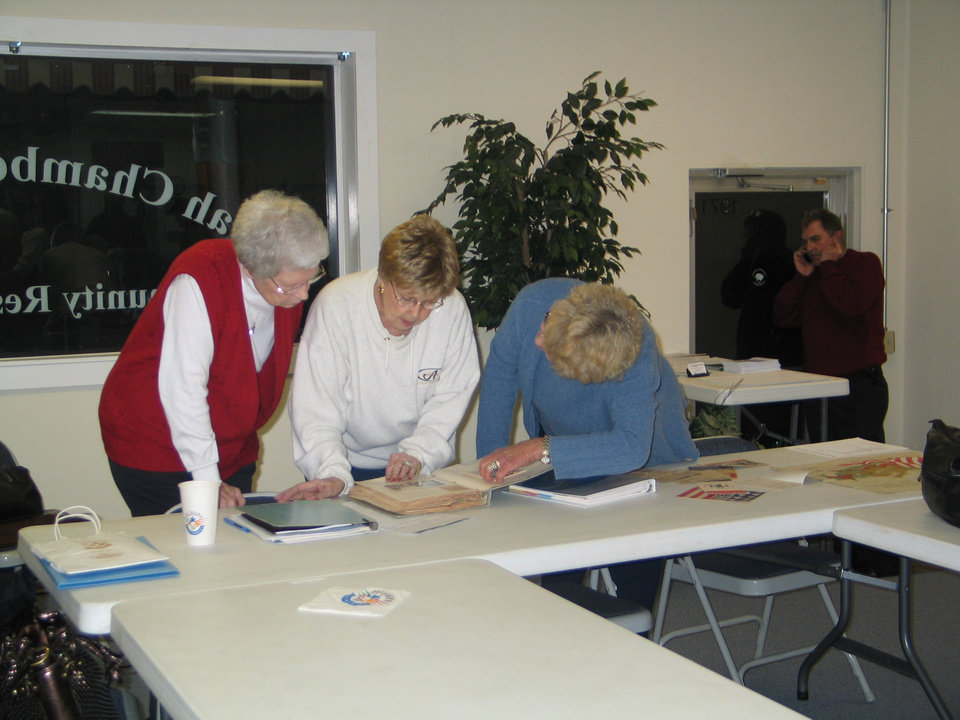 Ruth Shaw, Jeanie Weller, and Betty Batt look at recent acquisitions at the Harrah Historical Society's Centennial Celebration, November 15 Community Photo By: Karen Erbin, Editor Submitted By: Karen, Harrah
