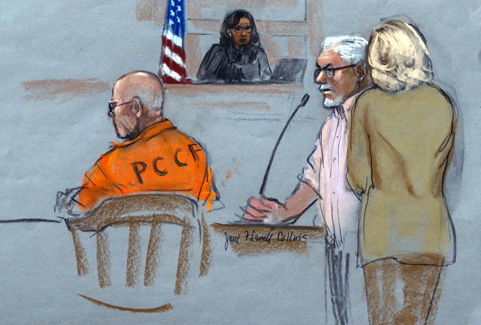 Photo - In this courtroom sketch, Steven Davis, second right, brother of slain Debra Davis, is comforted by his wife, right, as he testifies at the sentencing hearing for James