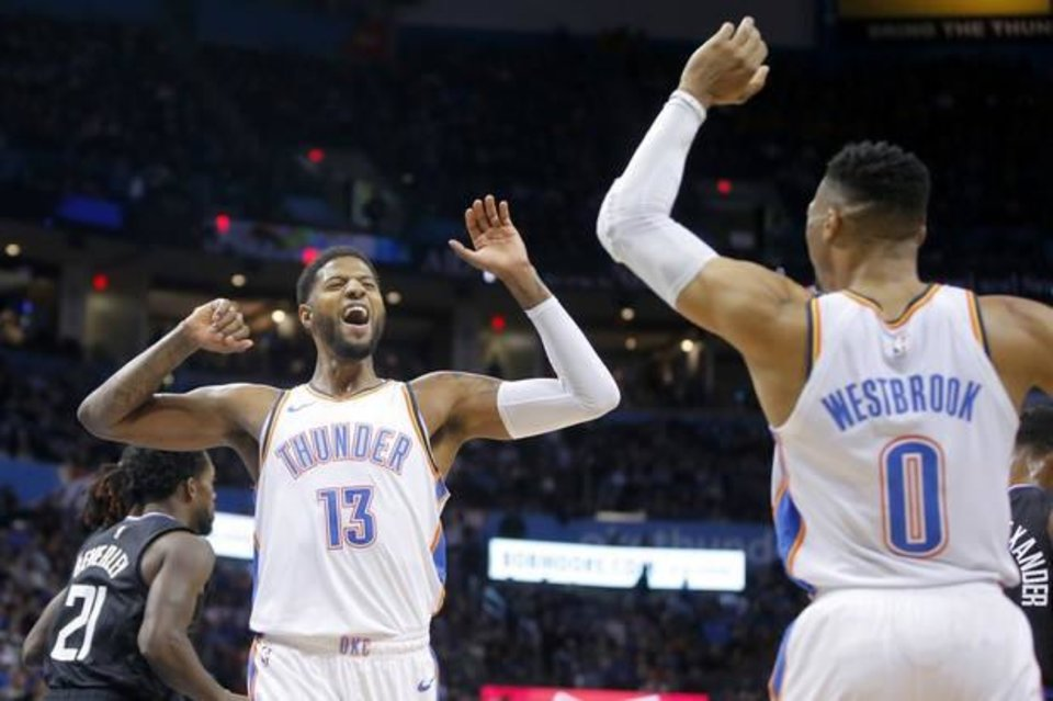 Photo -  Oklahoma City's Paul George, left, and Russell Westbrook will need to help keep the Thunder's momentum going forward during a best-of-7, first-round playoff series against the Portland Trail Blazers. Game 1 is 2:30 p.m. Sunday in Portland. [Bryan Terry/The Oklahoman]