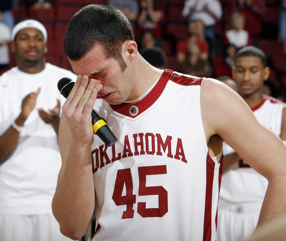 Photo - OU senior Beau Gerber (45) gets emotional as he speaks to fans and his teammates as part of Senior Day after the men's college basketball game between the Oklahoma Sooners and Texas A&M Aggies at Lloyd Noble Center in Norman, Okla., Saturday, March 6, 2010. Texas A&M won, 69-54. Photo by Nate Billings, The Oklahoman