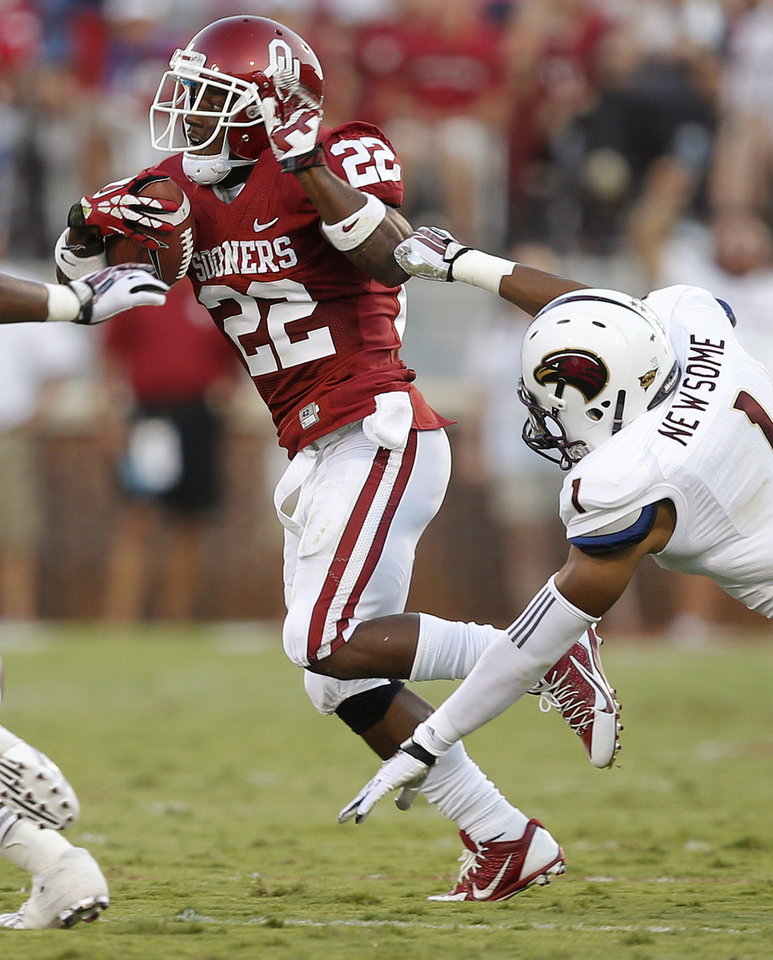 Photo - Oklahoma's Roy Finch (22) runs past Louisiana Monroe's Isaiah Newsome (1) during a college football game between the University of Oklahoma Sooners (OU) and the University of Louisiana Monroe Warhawks at Gaylord Family-Oklahoma Memorial Stadium in Norman, Okla., on Saturday, Aug. 31, 2013. Oklahoma won 34-0. Photo by Bryan Terry The Oklahoman