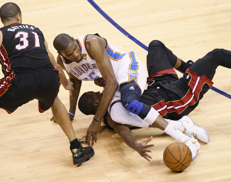 Photo - Oklahoma City's Kevin Durant (35) goes for the ball on top of Miami's Dwyane Wade (3) as Shane Battier (31) watches during Game 2 of the NBA Finals between the Oklahoma City Thunder and the Miami Heat at Chesapeake Energy Arena in Oklahoma City, Thursday, June 14, 2012. Photo by Nate Billings, The Oklahoman