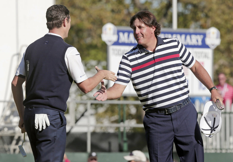 Photo - USA's Phil Mickelson, right, congratulates Europe's Justin Rose after a singles match at the Ryder Cup PGA golf tournament Sunday, Sept. 30, 2012, at the Medinah Country Club in Medinah, Ill. (AP Photo/Charlie Riedel)  ORG XMIT: PGA167