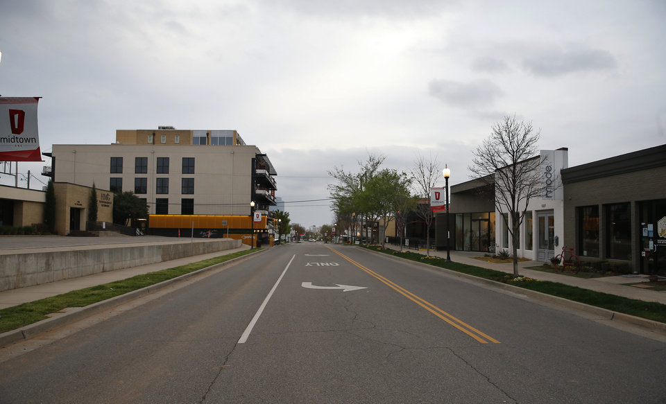 Photo - Empty streets are picture in Midtown in Oklahoma City,  Okla.,  Friday, March 27, 2020.  [Sarah Phipps/The Oklahoman]