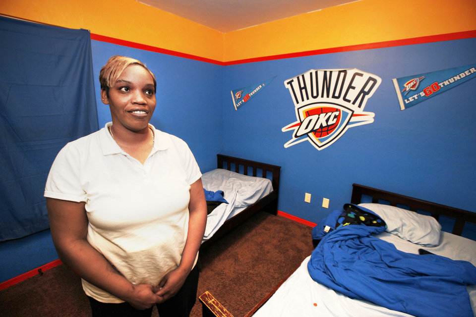 Photo - Homeowner Nicole Brown shows her sons' Thunder Room in her Central Oklahoma Habitat for Humanity-built house in Hope Crossing at NE 83 and Kelley Avenue.