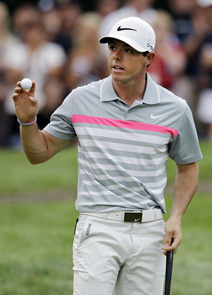 Photo - Rory McIlroy celebrates a birdie on the third hole during the final round of the Bridgestone Invitational golf tournament Sunday, Aug. 3, 2014, at Firestone Country Club in Akron, Ohio. (AP Photo/Mark Duncan)