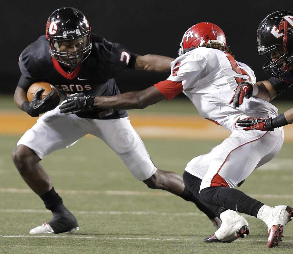 East Central's Stanvon Taylor (2) runs past Carl Albert's Bryan Williams (5) during the Class 5A Oklahoma state championship football game between Carl Albert High School and Tulsa East Central High School at Boone Pickens Stadium on Saturday, Dec. 1, 2012, in Stillwater, Okla.   Photo by Chris Landsberger, The Oklahoman