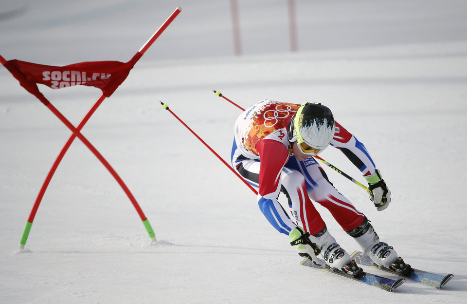 Photo - France's Alexis Pinturault passes a gate in the first run of the men's giant slalom at the Sochi 2014 Winter Olympics, Wednesday, Feb. 19, 2014, in Krasnaya Polyana, Russia. (AP Photo/Christophe Ena)