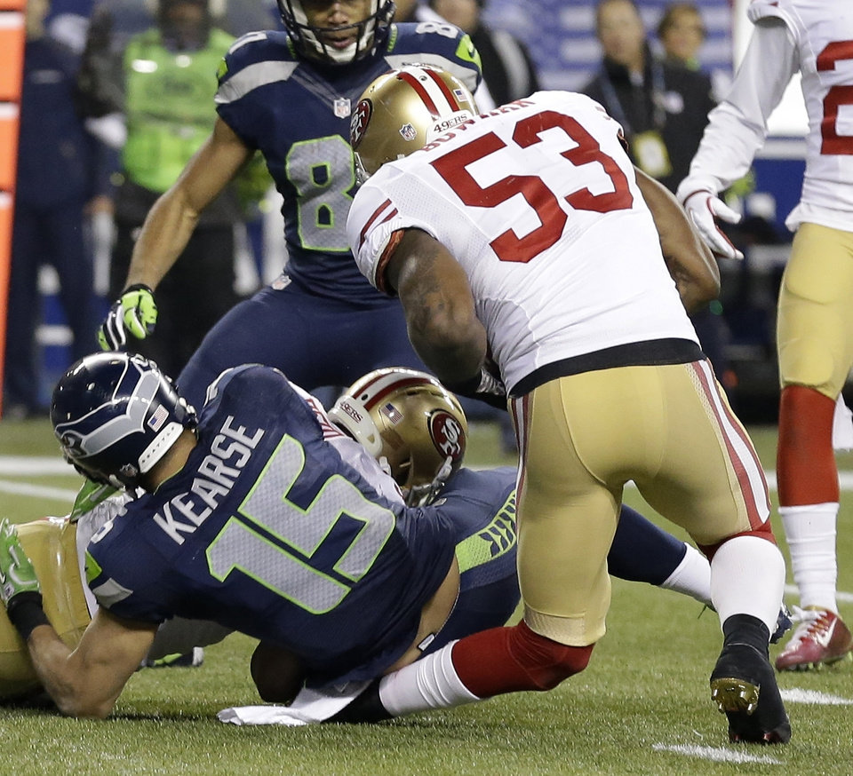 Photo - San Francisco 49ers' NaVorro Bowman injures his leg during the second half of the NFL football NFC Championship game against the Seattle Seahawks, Sunday, Jan. 19, 2014, in Seattle. (AP Photo/Elaine Thompson)