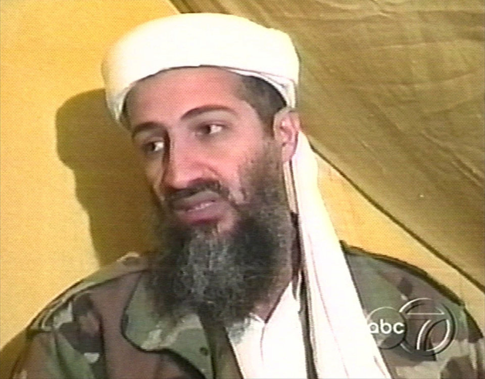 Photo - FILE - In this file image taken from video broadcast Thursday, Dec. 24, 1998, Osama bin Laden speaks during an interview at an undisclosed location in Afghanistan. A person familiar with developments said Sunday, May 1, 2011 that bin Laden is dead and the U.S. has the body. (AP Photo/ABC News, File) ORG XMIT: NY208