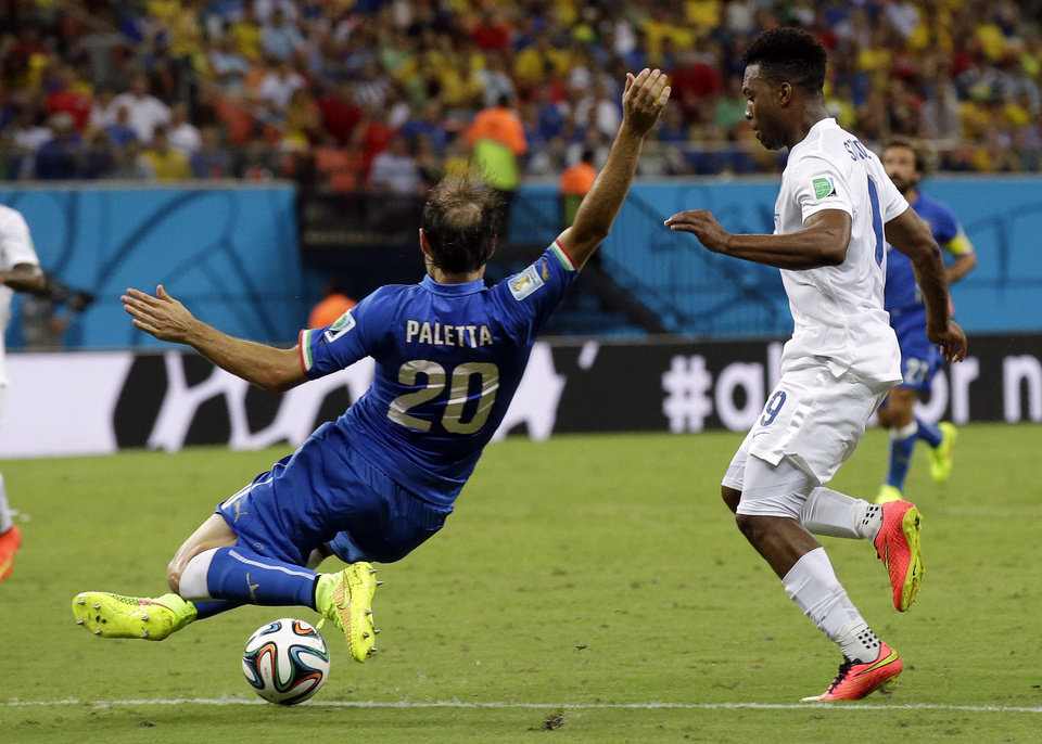 Photo - England's Daniel Sturridge, right, is challenged by Italy's Gabriel Paletta during the group D World Cup soccer match between England and Italy at the Arena da Amazonia in Manaus, Brazil, Saturday, June 14, 2014. (AP Photo/Matt Dunham)
