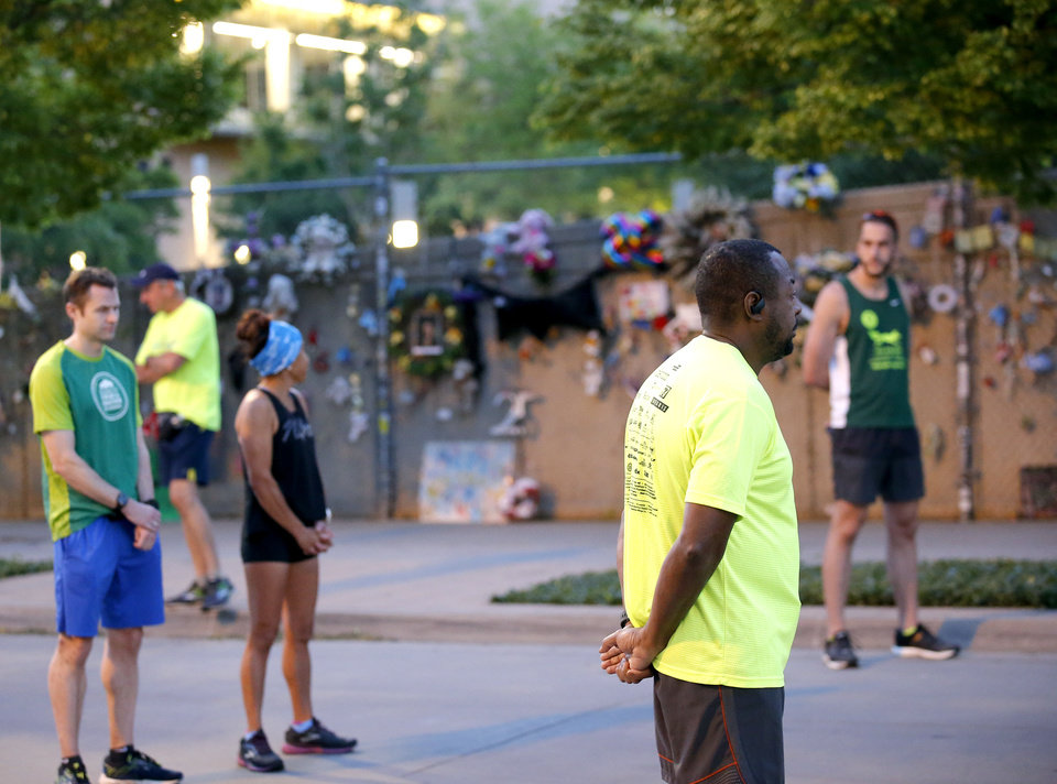 Photo - Barry Carrington pauses for a 168 seconds of silence before running the half marathon course of the Oklahoma City Memorial Marathon in Oklahoma City,  Sunday, April 26, 2020.  The 20th Oklahoma City Memorial Marathon was delayed until October because of Covid-19. [Sarah Phipps/The Oklahoman]