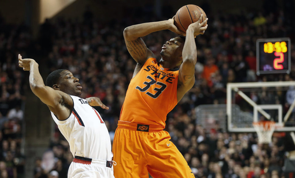 Photo - Oklahoma State's Marcus Smart (33) shoots over Texas Tech's Randy Onwuasor (1) during their NCAA college basketball game in Lubbock, Texas, Saturday, Feb, 8, 2014. (AP Photo/Lubbock Avalanche-Journal, Tori Eichberger)