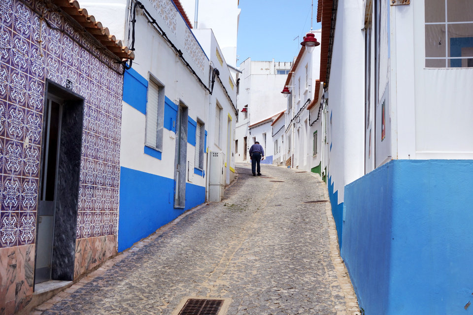 Photo -   Salema's little main drag, Rua dos Pescadores, hasn't changed over the years.  (photo: Robyn Stencil)