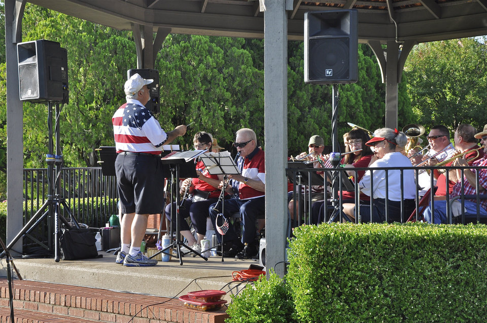Photo -  The Nichols Hills Band plays patriotic music for the Fourth of July. Photo by M. Tim Blake, for The Oklahoman   M. Tim Blake