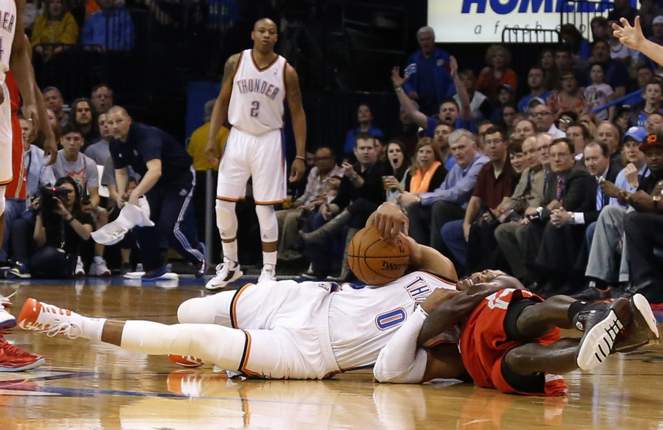 Photo - Oklahoma City Thunder guard Russell Westbrook (0) is fouled by Houston Rockets guard Pat Beverley during the first quarter of an NBA basketball game in Oklahoma City, Tuesday, March 11, 2014. (AP Photo/Sue Ogrocki)