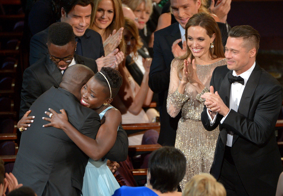 Photo - Director Steve McQueen, left, congratulates Lupita Nyong'o on her win for best actress in a supporting role for