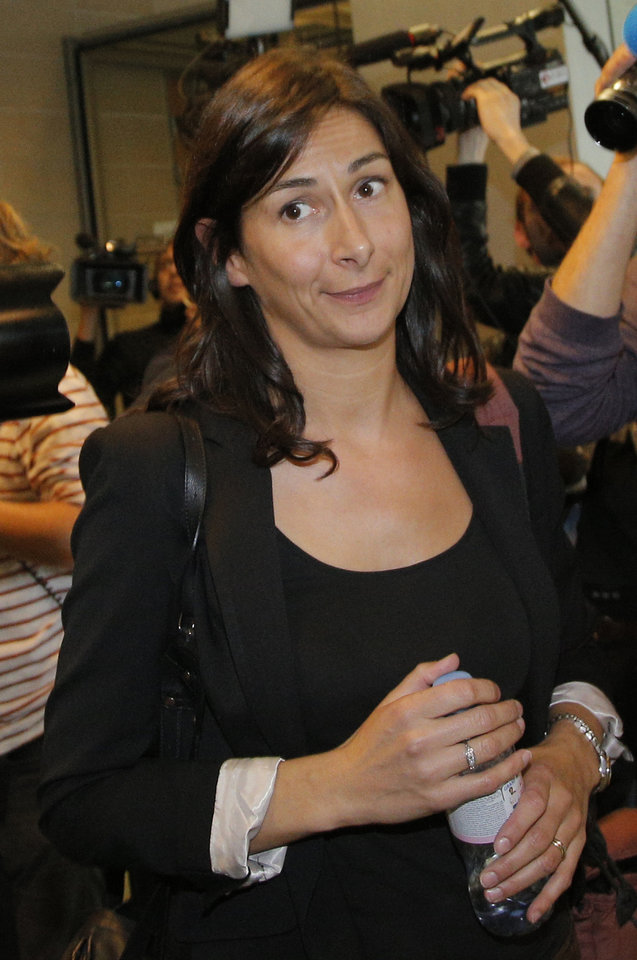 Photo -   French lawyer Delphine Pando for Closer magazine leaves the court in Nanterre, on the outskirts of Paris, Monday, Sept, 17, 2012 where lawyers for the British royal family sought an injunction against the Mondadori publishing house, owned by former Premier Silvio Berlusconi, which published a 26-page spread of topless photos of Prince William's wife Kate on Monday, to prevent further dissemination of the images. St. James's Palace said Sunday that family lawyers would file a criminal complaint against the unidentified photographer or photographers involved. The palace said it would be up to French prosecutors to decide whether to investigate and pursue a criminal case for breach of privacy or trespassing.(AP Photo/Francois Mori)
