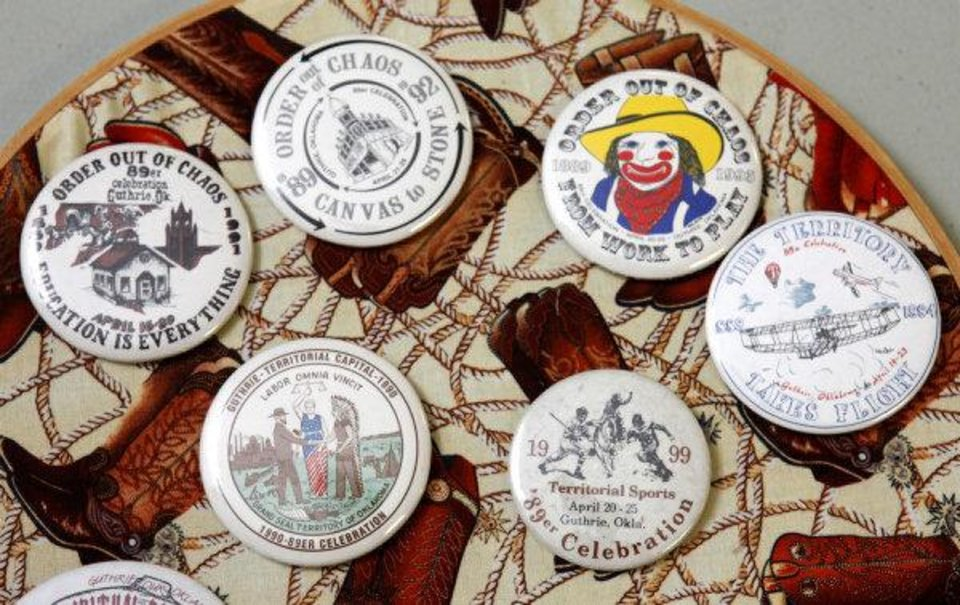Photo - Buttons from various 89er Day festivals will be auctioned to raise money for Guthrie's 89er Day parade. PHOTO BY PAUL HELLSTERN, THE OKLAHOMAN