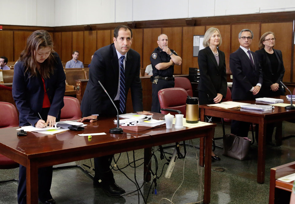 Photo - BNP Paribas general counsel Georges Dirani, second from right, flanked by attorneys Karen Patton Seymour, third from right, and Elizabeth Davy, stands before New York state Supreme Court Judge Michael Ovitz, in New York, Monday, June 30, 2014. At left are District Attorneys Kim Han and Edward Starishevsky. France's largest bank, BNP Paribas, pleaded guilty Monday and agreed to pay nearly $9 billion to resolve criminal allegations that it processed transactions for clients in Sudan and other blacklisted countries in violation of U.S. trade sanctions. (AP Photo/Richard Drew)
