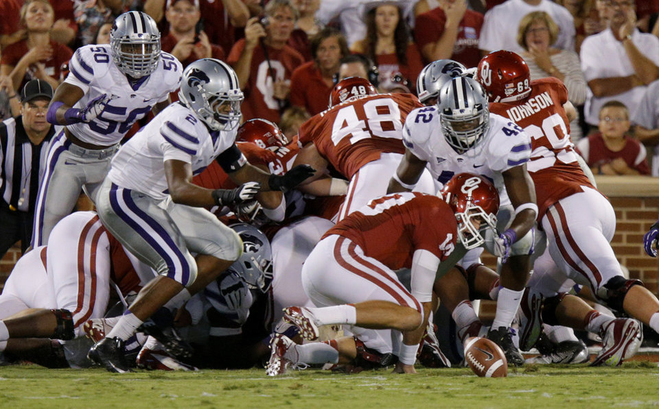 Oklahoma\'s Blake Bell (10) fumbles the ball as Kansas State\'s Meshak Williams (42) goes for the ball during a college football game between the University of Oklahoma Sooners (OU) and the Kansas State University Wildcats (KSU) at Gaylord Family-Oklahoma Memorial Stadium, Saturday, September 22, 2012. Photo by Bryan Terry, The Oklahoman