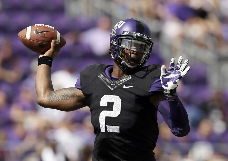 Photo - FILE -  In this Oct. 12, 2013, file photo, TCU quarterback Trevone Boykin passes against Kansas in the first half of an NCAA college football game in Fort Worth, Texas. TCU head coach Gary Patterson says
