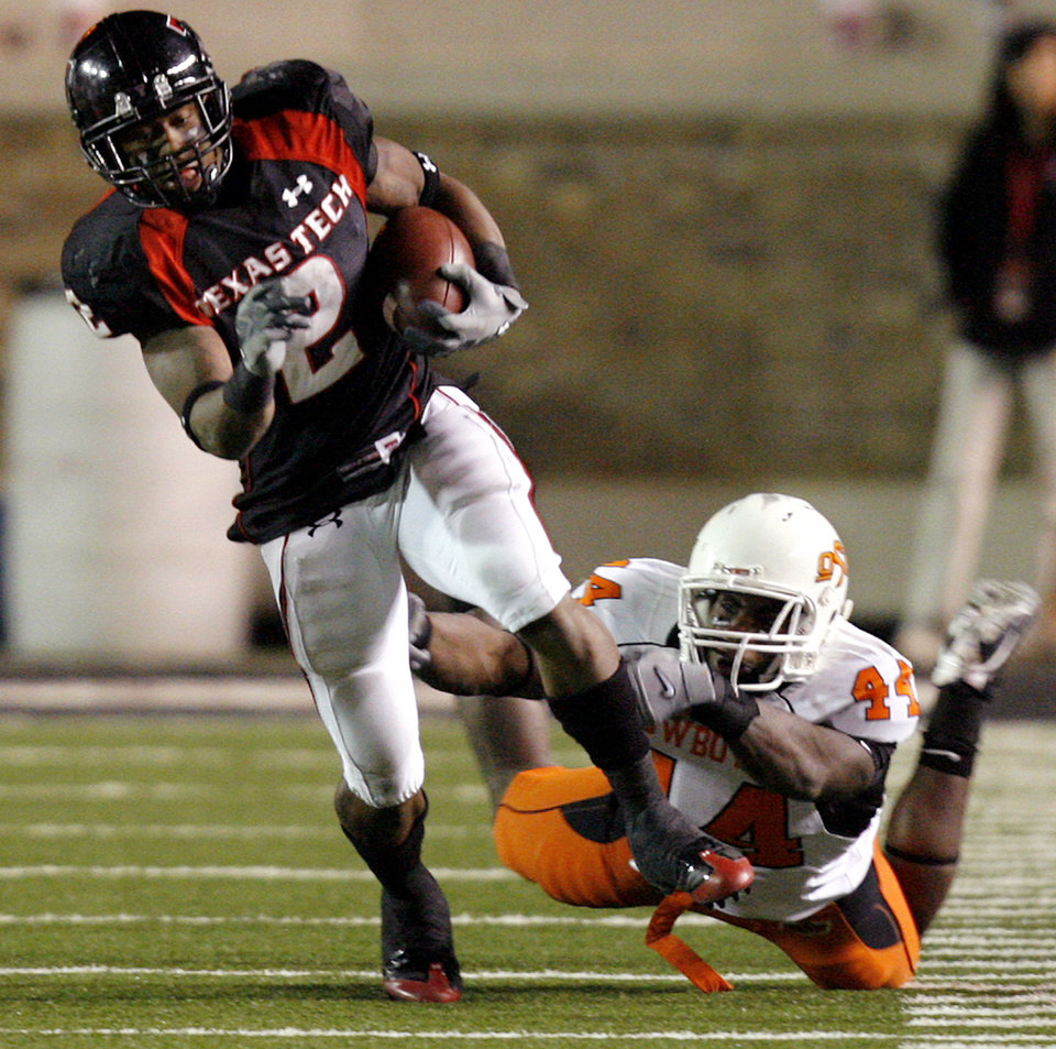 Photo - Texas Tech's Shannon Woods (2) gets by Oklahoma State's Donald Booker (44) during the second half of the college football game between the Oklahoma State University Cowboys (OSU) and the Texas Tech Red Raiders at Jones AT&T Stadium on Saturday, Nov. 8, 2008, in Lubbock, Tex.BY CHRIS LANDSBERGER/THE OKLAHOMAN