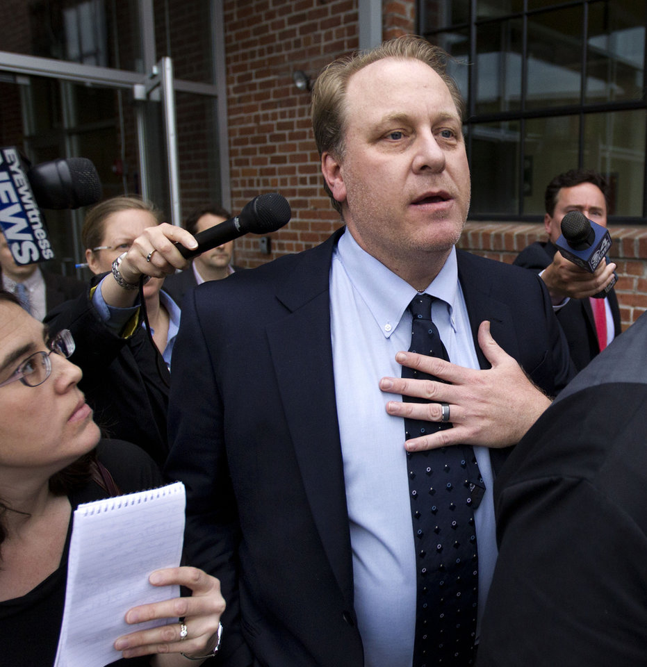 Photo -   Former Boston Red Sox pitcher Curt Schilling, center, is followed by members of the media as he departs the Rhode Island Economic Development Corporation headquarters, in Providence, R.I., Wednesday, May 16, 2012. Schilling briefed Rhode Island Gov. Lincoln Chafee and economic development officials Wednesday during a closed-door meeting that could determine the fate of his video game company. (AP Photo/Steven Senne)