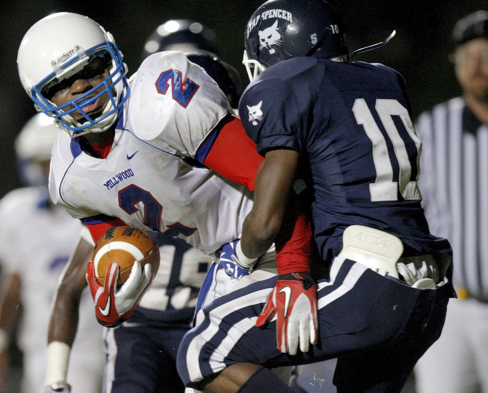 Millwood's Marc Robinson pushes Star Spencer's Milon Smith into the end zone as he scores a touchdown during a high school football game at Star Spencer in Oklahoma City, Friday, September 2, 2011. Photo by Bryan Terry, The Oklahoman
