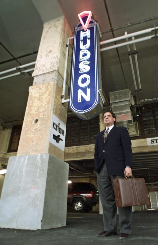Photo -  Nicholas (Nick) J. Preftakes, Precor Realty Advisors Inc. president, in the downstairs garage of the Hudson-Essex Office Loft Offices at Automobile Alley at 825 N. Broadway