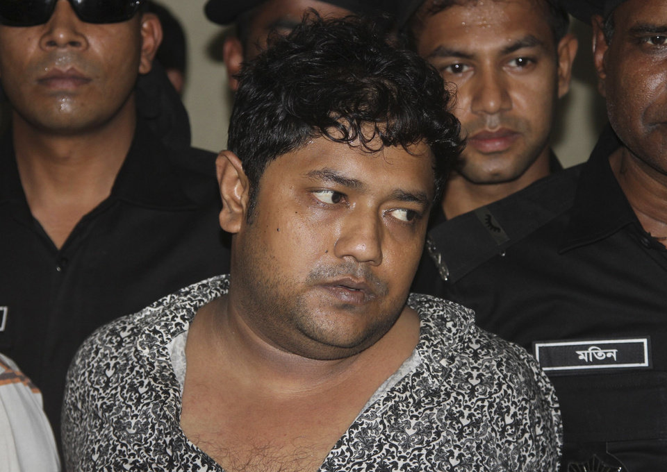 Photo - Mohammed Sohel Rana, the fugitive owner of an illegally-constructed building that collapsed last week in Bangladesh, killing some 377 people, is paraded by Rapid Action Battalion commandoes for the media along with unidentified alleged accomplices, not pictured, in Dhaka, Bangladesh, Sunday, April 28, 2013.  Rana was arrested near the land border in Benapole in western Bangladesh, just as he was about to flee into India's West Bengal state, said Jahangir Kabir Nanak, junior minister for local government. (AP Photo/Palash Khan)
