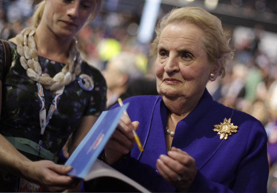 Photo - Former Secretary of State Madeleine Albright signs autographs as she arrives at the Democratic National Convention in Charlotte, N.C., on Wednesday, Sept. 5, 2012. (AP Photo/David Goldman)  ORG XMIT: DNC764