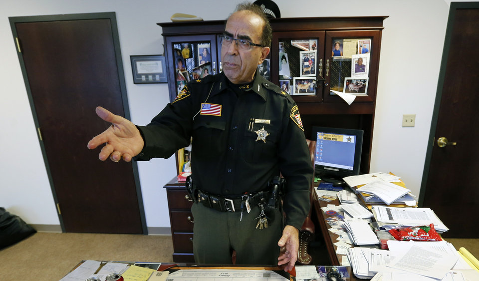 Jefferson County Sheriff Fred Abdalla talks about how the FBI is investigating cyber threats in the eastern Ohio city that include a death threat received by the sheriff in his office on Wednesday, Jan. 9, 2013, in Steubenville, Ohio. (AP Photo/Keith Srakocic)