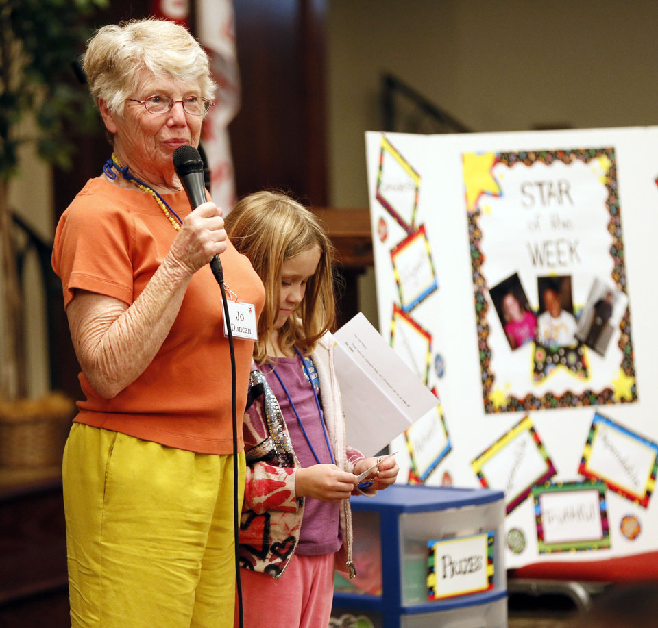 "Jo Duncan, a volunteer from United Methodist Church of the Servant, introduces Alexis Morgan, 8, as one of the ""Stars of the Week"" to other students and tutors during Whiz Kids at Wesley United Methodist, 1401 NW 25.  <strong>NATE BILLINGS - NATE BILLINGS</strong>"