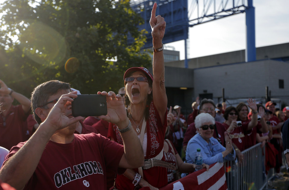 Photo - Jan Gillespie cheers before the college football game between West Virginia  Mountaineers and the University of Oklahoma Sooners at Milan Puskar Stadium in Morgantown, W.Va., Saturday, Sept. 20, 2014. Photo by Sarah Phipps, The Oklahoman