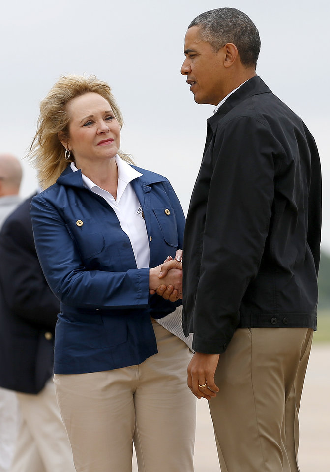 Photo - Oklahoma Gov. Mary Fallin greets President Obama at Tinker Air Force Base after his arrival Sunday May 26, 2013. The President is in Oklahoma to tour the Moore tornado area and meet with families.  Photo by Bryan Terry, The Oklahoman ORG XMIT: OKC1305261411038212