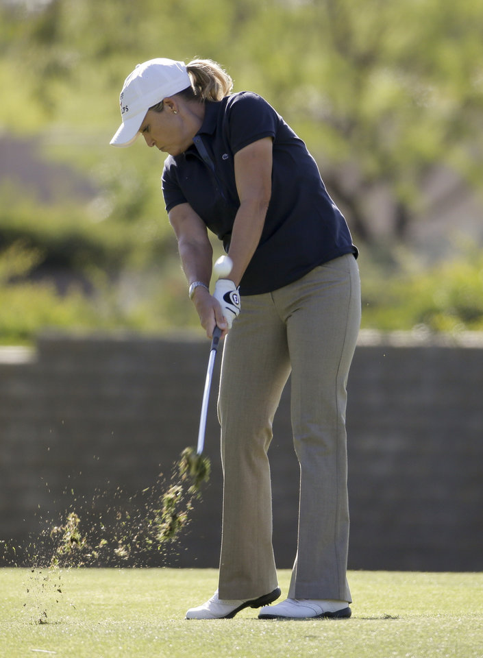 Photo - Cristie Kerr hits from the fairway on the 15th hole during the first round at the LPGA Kraft Nabisco Championship golf tournament Thursday, April 3, 2014, in Rancho Mirage, Calif. (AP Photo/Chris Carlson)
