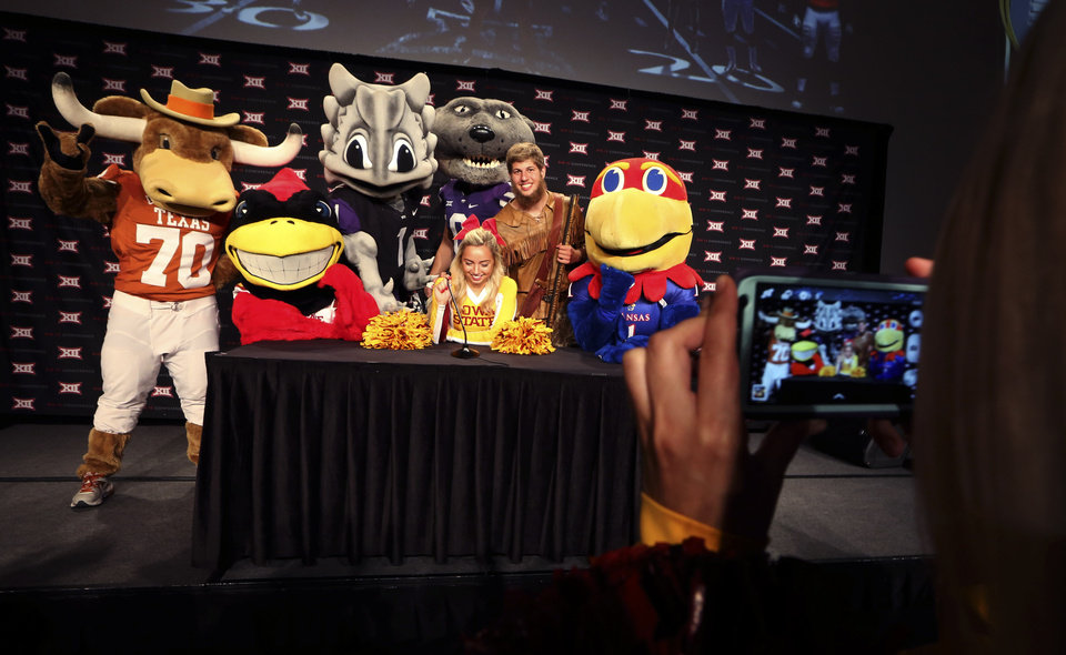 Photo - A cheerleader poses for a photo with team mascots during the NCAA college Big 12 Conference Football media days in Dallas, Monday, July 21, 2014. (AP Photo/LM Otero)
