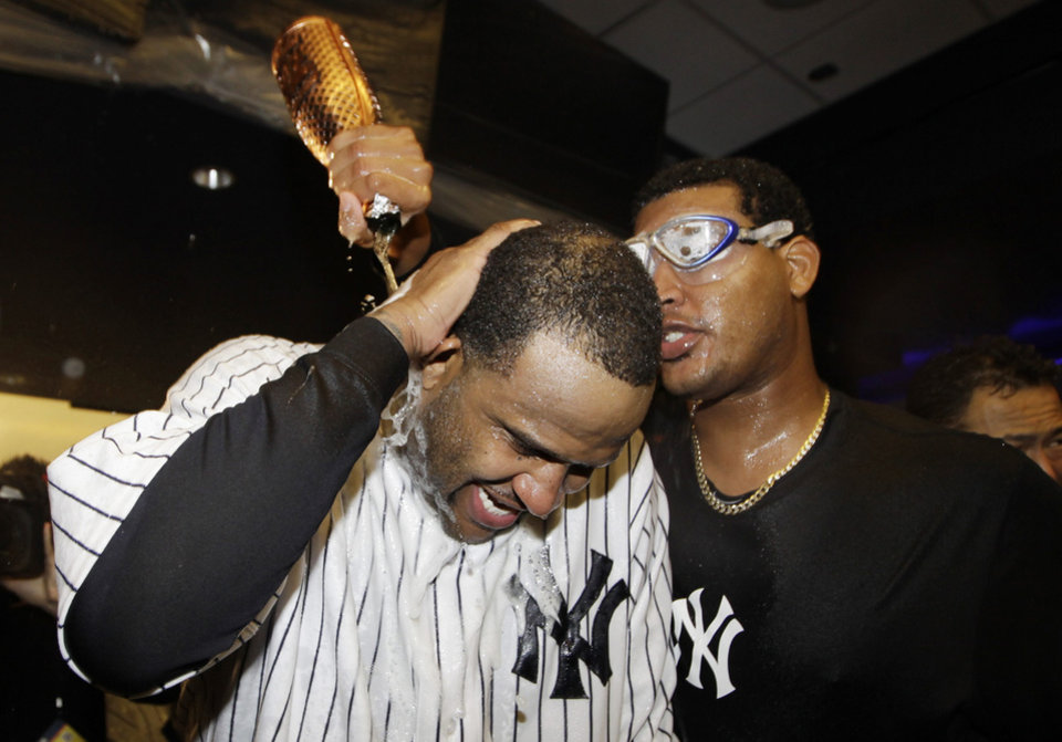 Photo -   New York Yankees starting pitcher CC Sabathia is doused by teammate Ivan Nova, right, as they celebrate in the clubhouse after Game 5 of the American League division baseball series against the Baltimore Orioles, Friday, Oct. 12, 2012, in New York. The Yankees won the game 3-1 and advanced to the AL championship. (AP Photo/Kathy Willens)