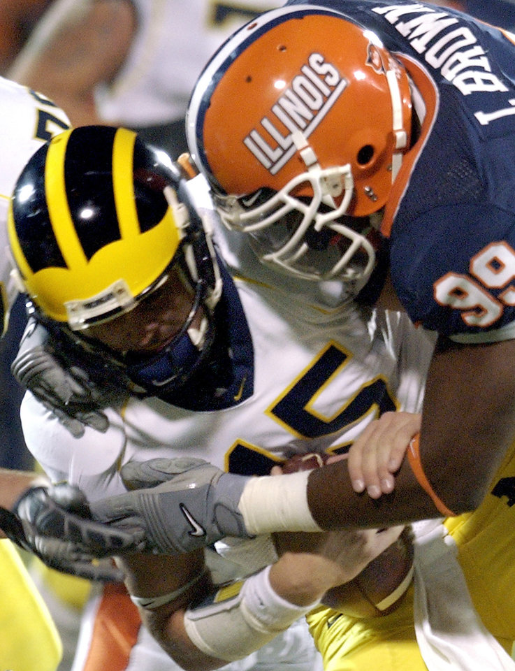 FILE - In this Oct. 20, 2007, file photo, Illinois' Jerry Brown (99) sacks Michigan quarterback Ryan Mallett (15) during an NCAA college football game in Champaign, Ill. Dallas Cowboys defensive lineman Josh Brent is facing an intoxication manslaughter charge after a one-vehicle accident that killed Brown, a member of the team's practice squad. Irving police spokesman John Argumaniz said the accident happened about 2:20 a.m. in Saturday, Dec. 7, 2012, in the Dallas suburb.  (AP Photo/Holly Hart, File)