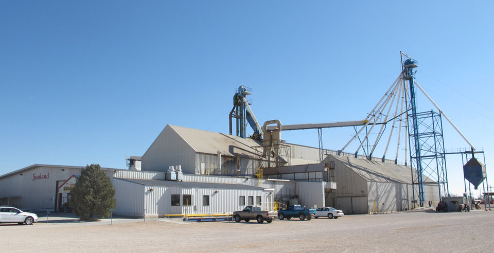 This Nov. 27, 2012 photo shows the Sunland Inc. peanut butter and nut processing plant in eastern New Mexico, near Portales, which has been shuttered since late September due to a salmonella outbreak that sickened dozens. The Food and Drug Administration on Monday, Nov. 26, 2012, suspended the registration of Sunland Inc., which is the country's largest organic peanut butter processor. FDA officials found salmonella in numerous locations in Sunland's processing plant after 41 people in 20 states, most of them children, were sickened by peanut butter manufactured at the Portales, N.M., plant and sold at the Trader Joe's grocery chain. The company had announced plans to reopen its peanut processing facility on Tuesday after voluntarily shutting down earlier this fall. (AP Photo/Jeri Clausing)
