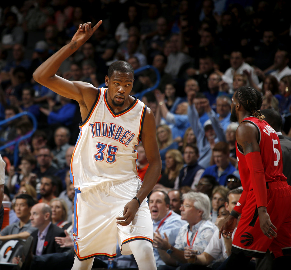 Photo - Oklahoma City's Kevin Durant (35) celebrates after a basket during an NBA basketball game between the Oklahoma City Thunder and the Toronto Raptors at Chesapeake Energy Arena on Wednesday, Nov. 4, 2015. The Thunder lost 103-98. Photo by Bryan Terry, The Oklahoman