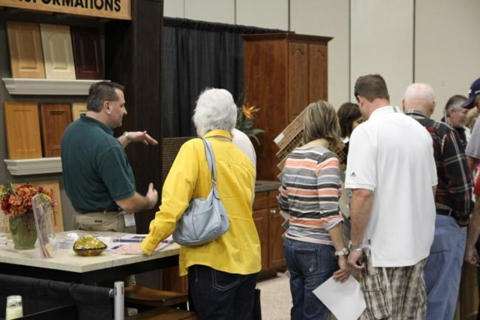 Photo -  Attendees listen to an exhibitor at a previous Oklahoma City Spring Remodel & Landscape Show. [PHOTO PROVIDED]